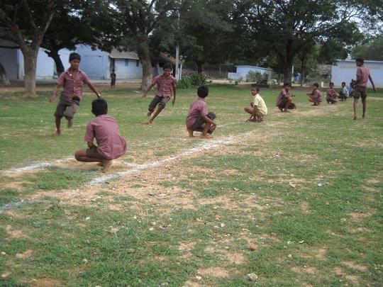 Boys playing kho-kho game