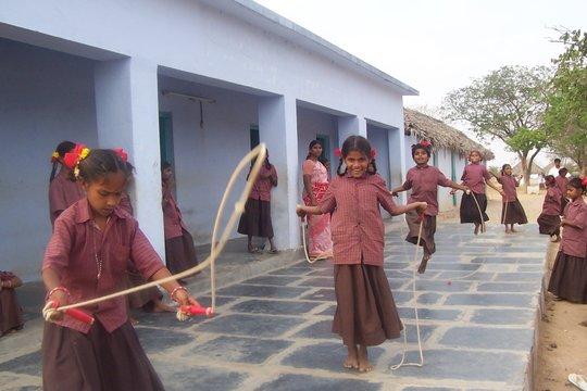 Girl children playing skipping rope