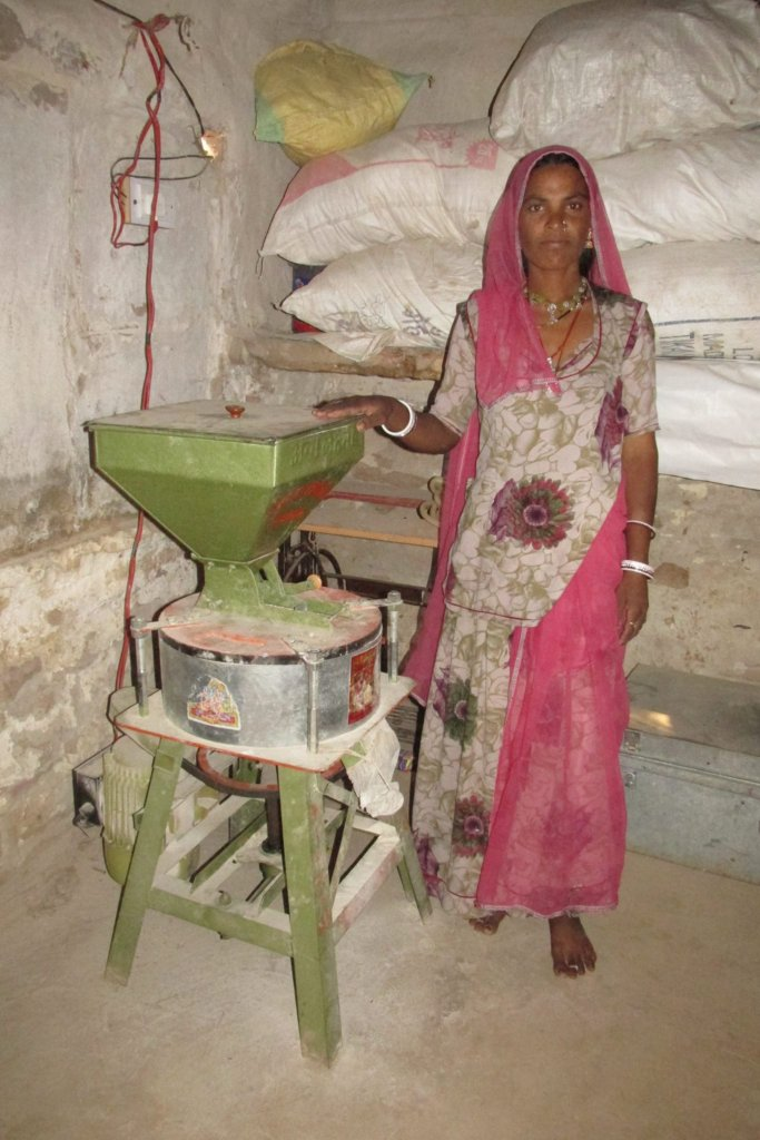 Chandu Devi with her flour-grinding mill