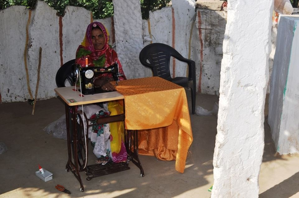 SHG member with her new sewing machine..