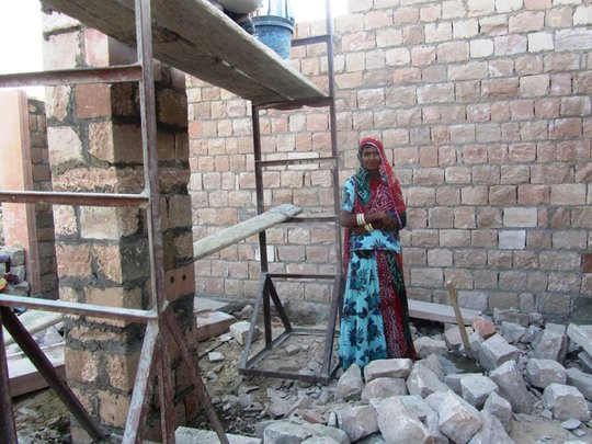 SHG member with construction for her new shop