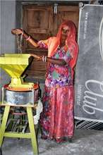 SHG member with her flour machine