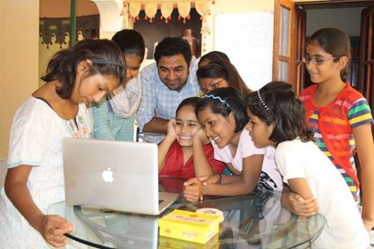 Very happy girls with their new laptop