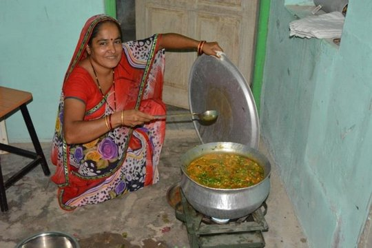 Meera making dhal and palak in Nutrition workshop