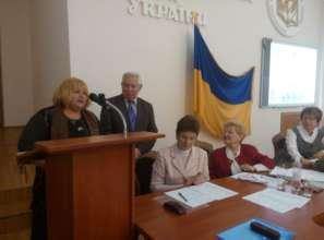 Patronage carer Tetiana Gurska being awarded...
