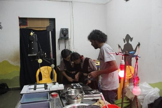 Kids working in darkroom