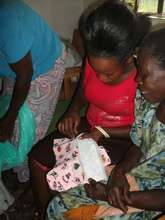 a woman being trained to make re-usable pads
