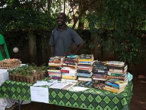 Fred Kyakonye busy selling herbs and used books