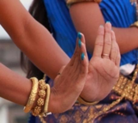 A dancers hands create the Suprech (prayer)