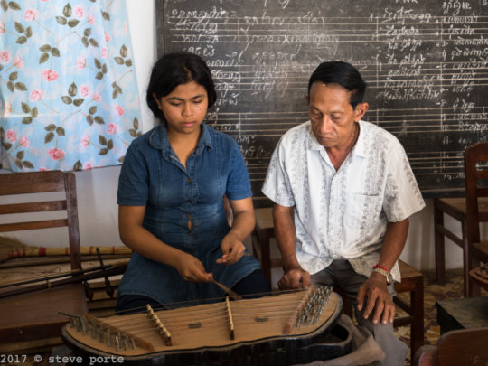 Our Mohori teacher teaching the Khim instrument