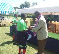 education officer awarding a student