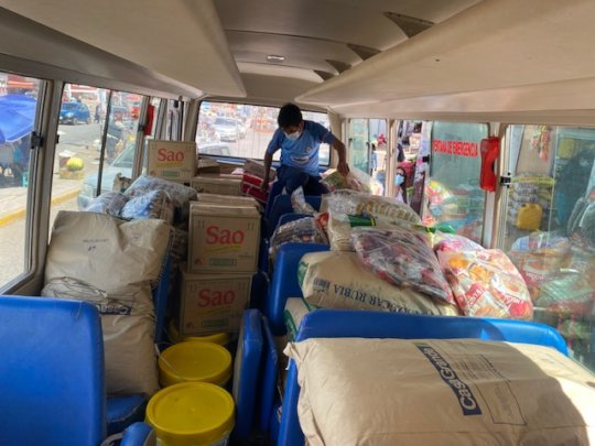 CW bus loaded-emerg food staples for families.