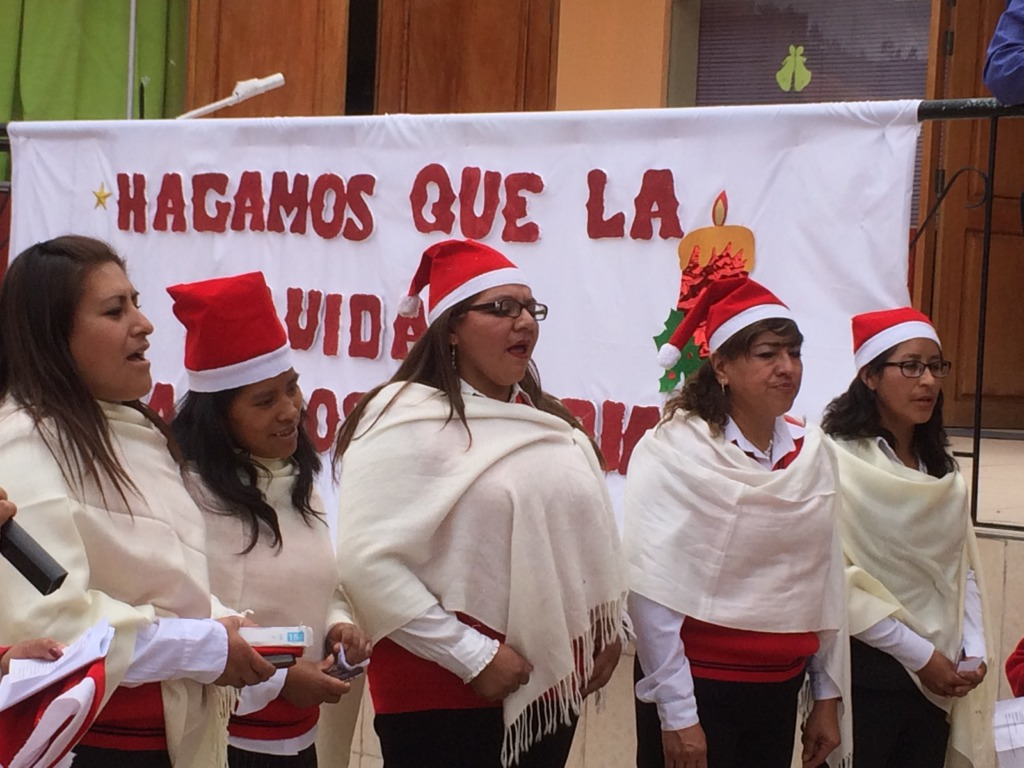 Our teachers lead girls in Christmas songs