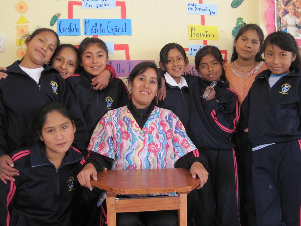 Leydi upper left, classmates and teacher