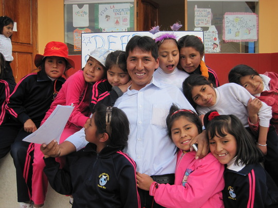 CW Efrain surrounded by loving students.