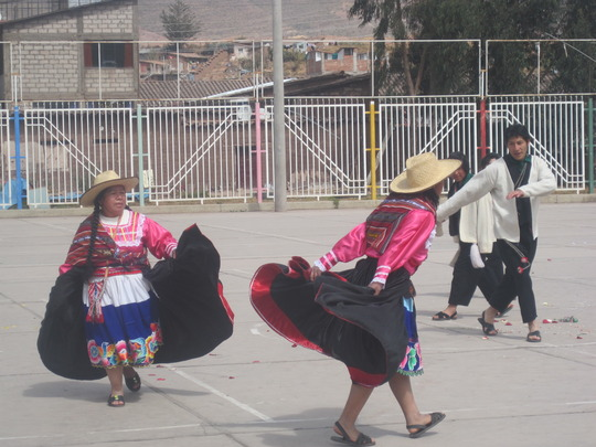 Typical dance in special costume by parents