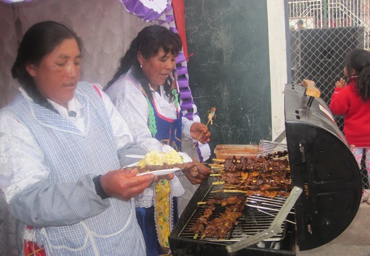 Class mothers cooking food to sell to the audience