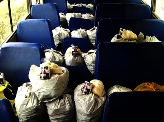 CW School Bus loaded with emergency food aid