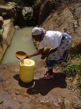 Woman fetching water from the Kitui Spring
