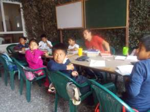 Saul teaching younger students in La Academia