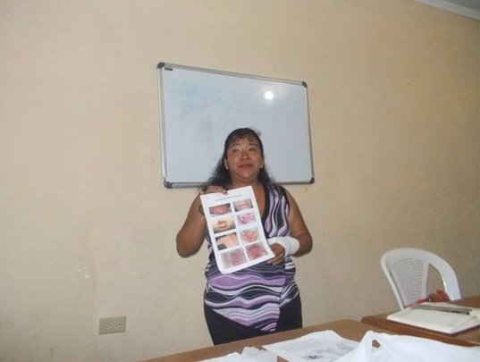 Marisol showing the students images of STDs