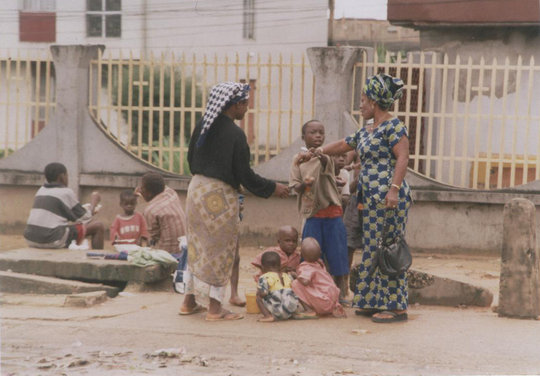 Mother and children begging on busy streets- risky
