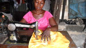 A woman learning to sew dress
