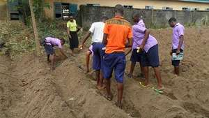 Boys and girls receiving instructions on farming