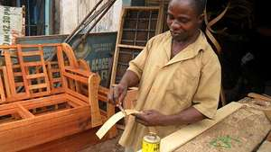 A boy learning carpentry work, needs modern tools