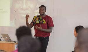 Alloysius Attah of Farmerline speaking in class.