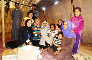 RI delivering a hygiene kit to Mumtaz's family
