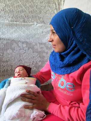 Mother and newborn child.