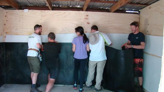 Volunteers building the Quarantine room.