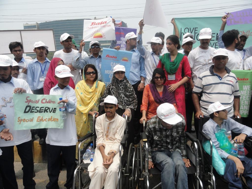 Awareness walk by volunteers and special children