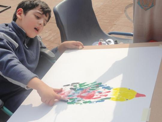 A special Kid doing art work