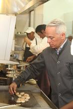 Iron Chef Zacharian preparing the benefit dinners