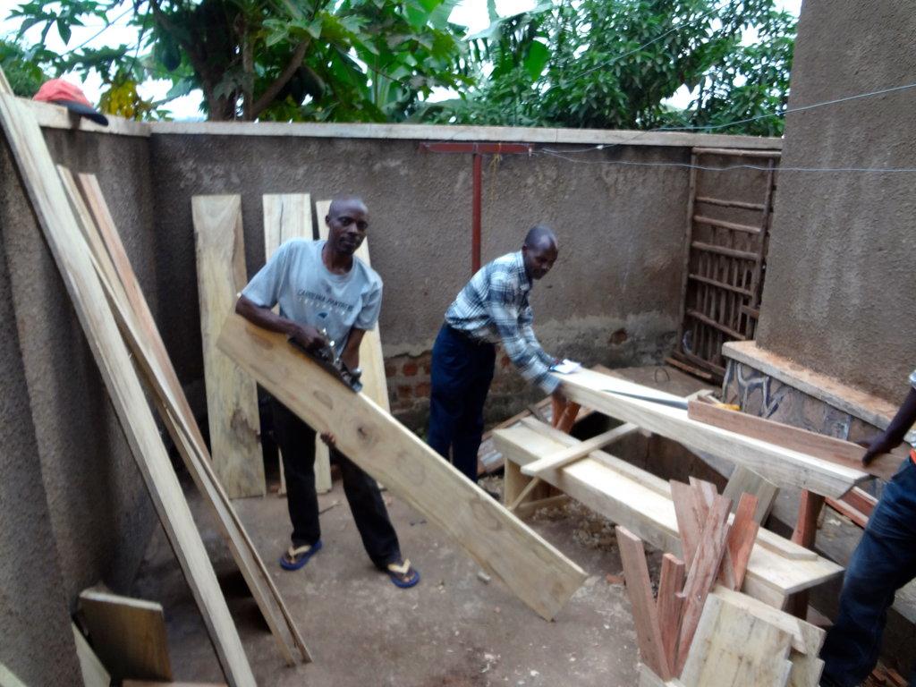 Papa Baraka builds desks and Bolingo helps