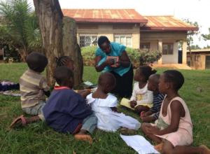 Teacher Jacqueline working with children
