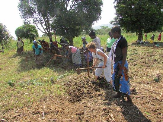 Carol & Jinja beaders hand hoeing new land Feb2014