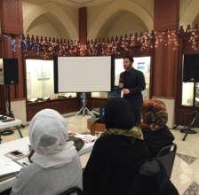 Students listen to peer educator Ali Shahin