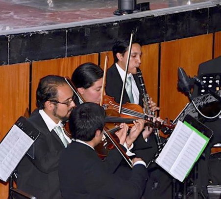 Giovanni and students in pit orchestra