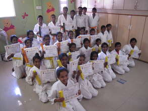 yellow orange and green belts in karate