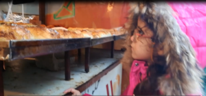 A child buys unhealthy & dirty street food