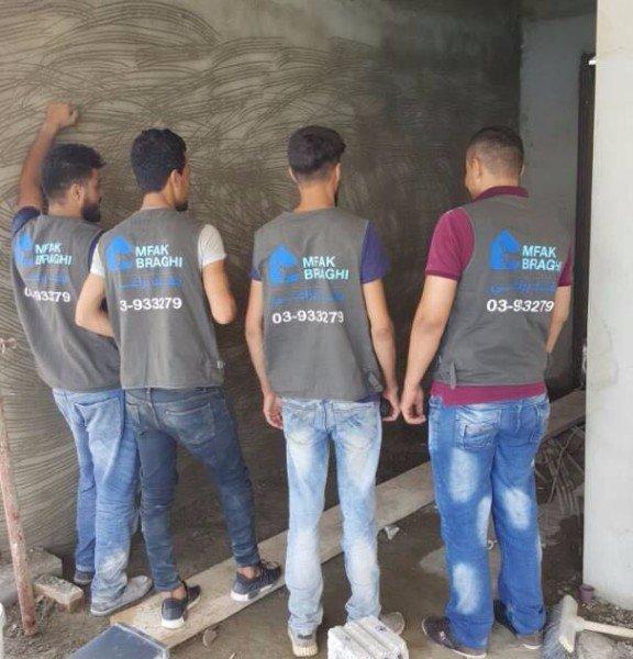 Mfak Braghi team on-site showing off their vests!