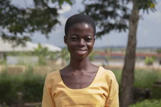 Esther - now a proud secondary school student!