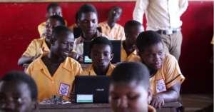 Computer class - three children per laptop!