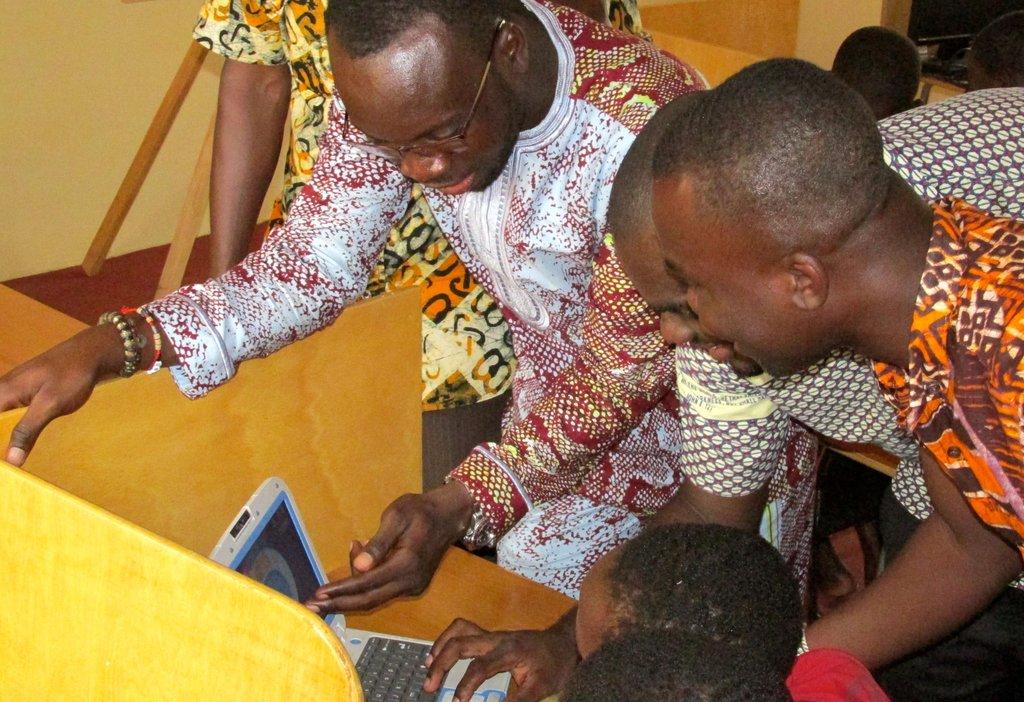 Teachers learn practical computer teaching skills.