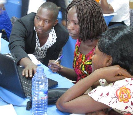 Teachers practise using laptops.