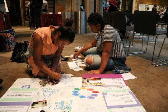 Participants prepare to present at Emoti-con!