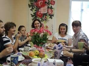 Teacher Olga and mentor Nikolay with students